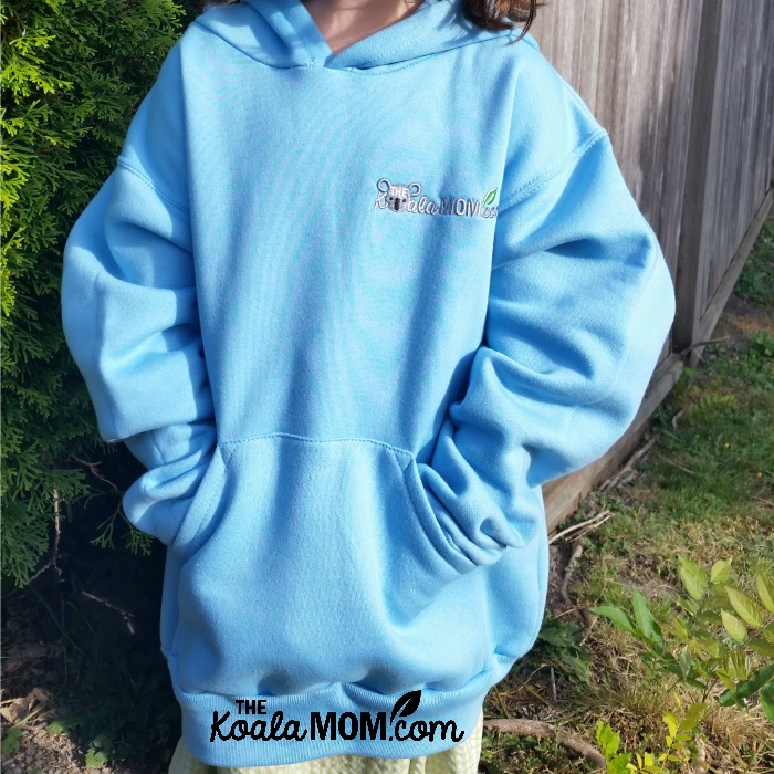 School clothing from Bravo apparel - a blue girls' hoodie with the Koala Mom logo on it