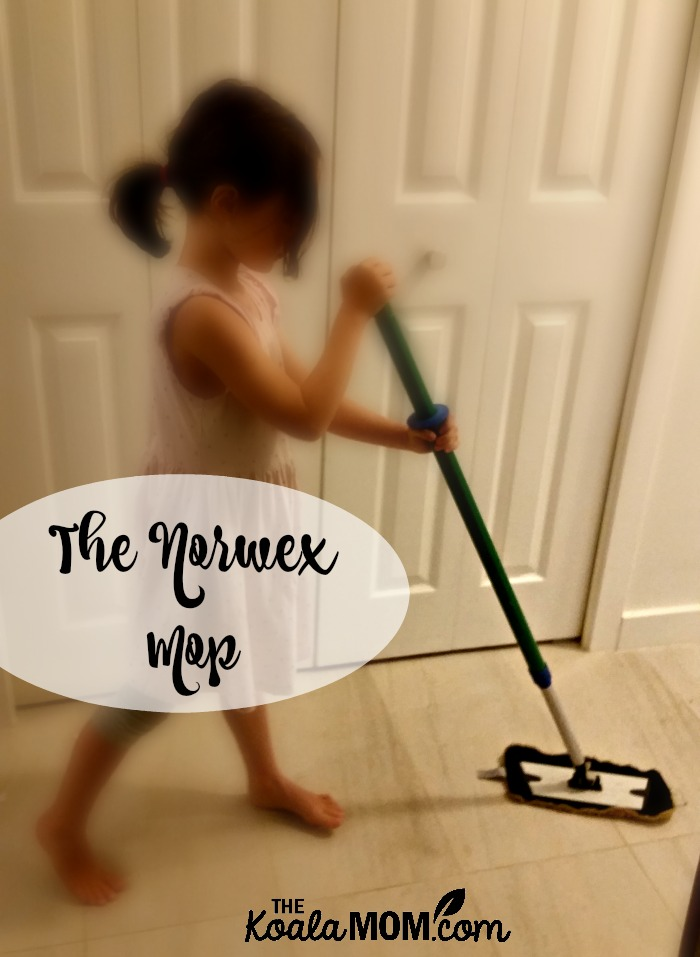 6-year-old sweeping the floor with the Norwex mop