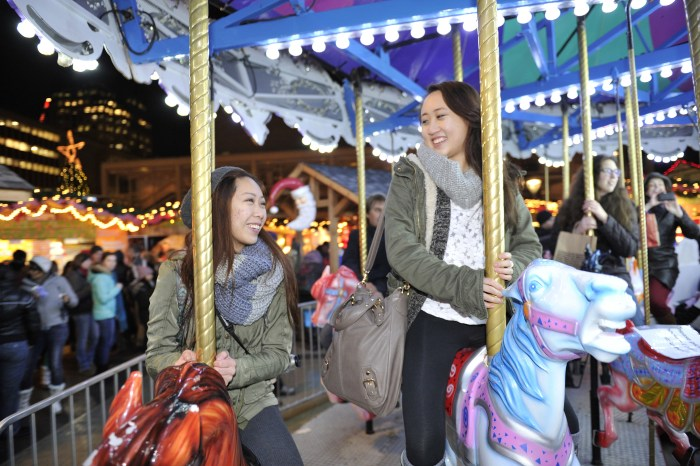 Girls on carousel horses at the Vancouver Christmas Market