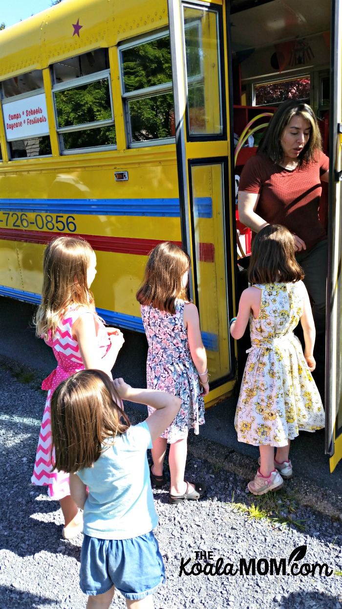 All aboard the Vancouver Tumblebus! Children at a Tumblebus birthday party line up to play on the bus.