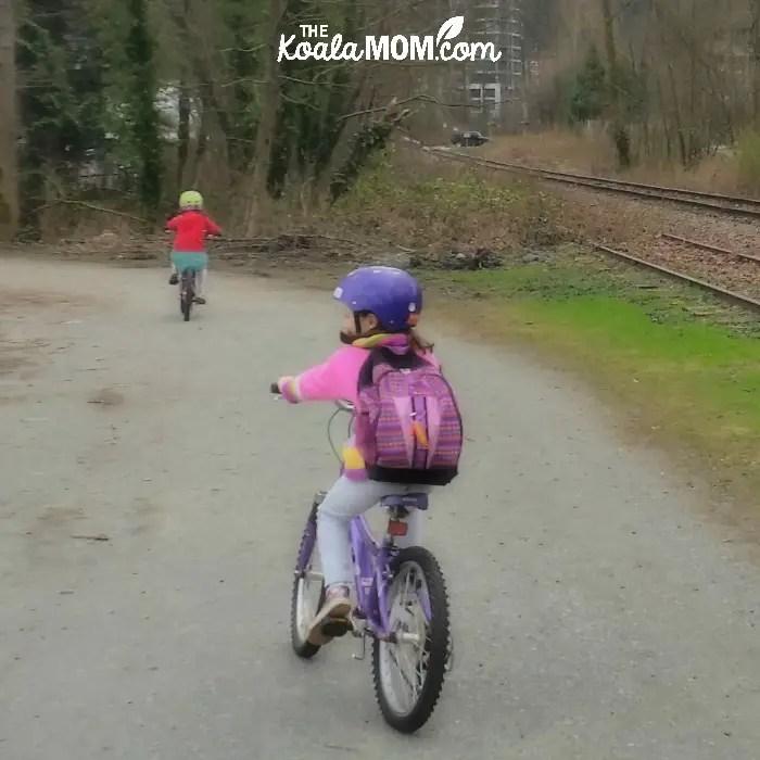 Sunshine and Lily biking