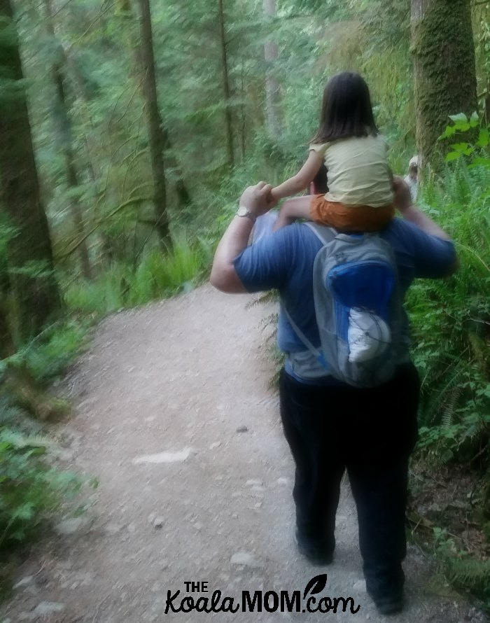 Jade riding on Daddy's shoulders along the Buntzen Lake Trail