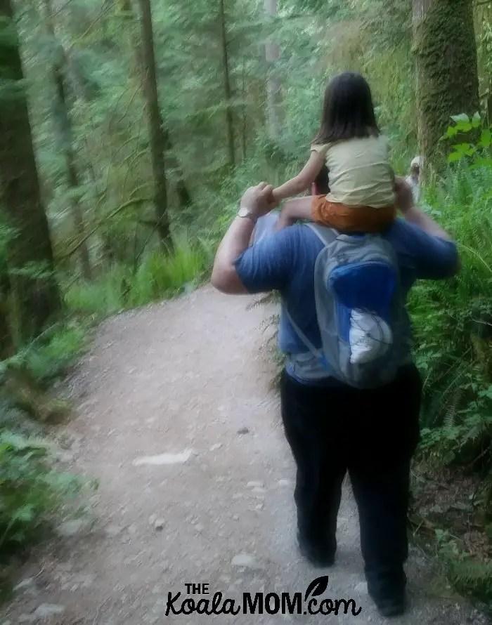 Jade riding on Daddy's shoulders along the Buntzen Lake Trail