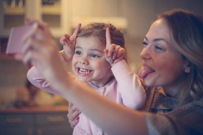 Mom and daughter taking a silly selfie