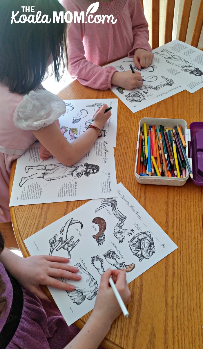 Girls colouring their pirate clothes for the Pirate Panoply game from Homeschool in the Woods
