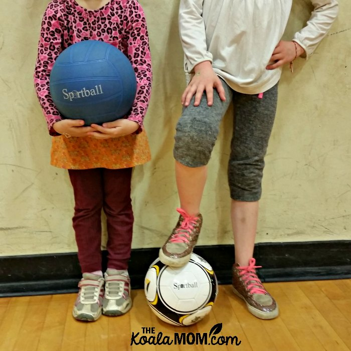 Two girls holding Sportball balls.