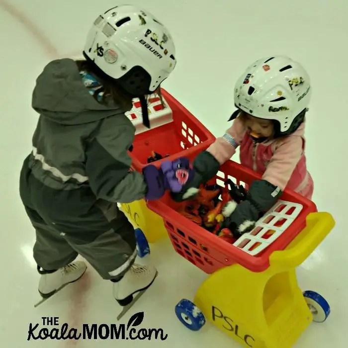 Jade (age 4) and Pearl (age 2) play together at the skating rink.
