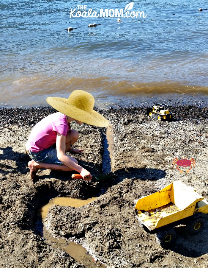 8-year-old playing in the sand at Cultus Lake Beach.