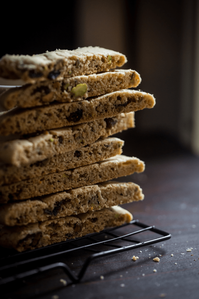 biscotti stacked on a cooling rack