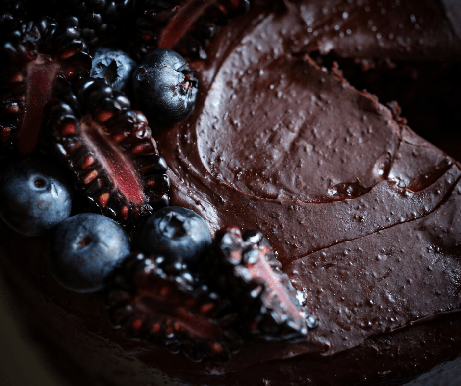 top view of chocolate frosting and berries on top of cake