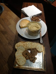 We served crackers with cheese and hummus.