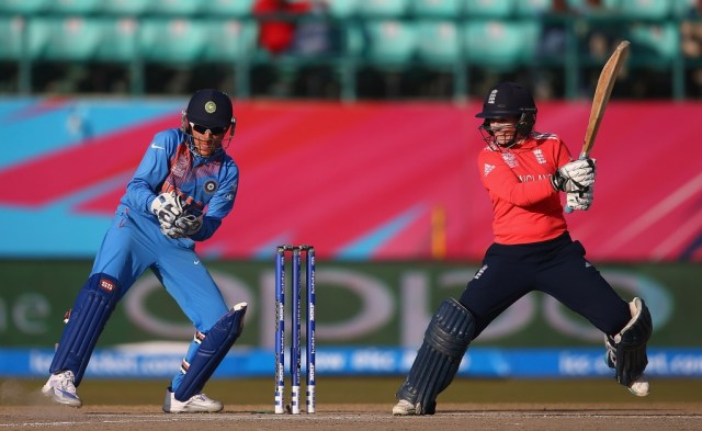 """DHARAMSALA, INDIA - MARCH 22: Tammy Beaumont of England hits the ball towards the boundary, as Sushma Verma of India looks on during the Women's ICC World Twenty20 India 2016 match between England and India at the HPCA Stadium on March 22, 2016 in Dharamsala, India. (Photo by Matthew Lewis-IDI/IDI via Getty Images)"""