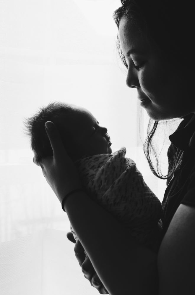 Black and white photo mother and new baby