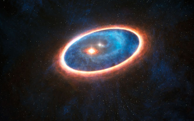 This artist's impression shows the dust and gas around the double star system GG Tauri-A. Researchers using ALMA have detected gas in the region between two discs in this binary system. This may allow planets to form in the gravitationally perturbed environment of the binary. Half of Sun-like stars are born in binary systems, meaning that these findings will have major consequences for the hunt for exoplanets.
