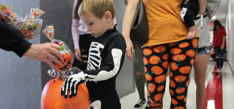 Masked munchkins: Littlest Cowboys go trick-or-treating early around the CCHS campus