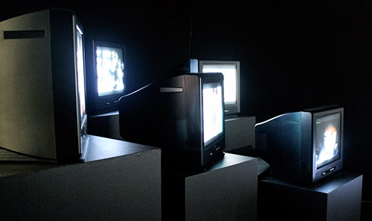 In the Encyclonospace Iranica exhibit, television monitors are used to address the problem of human-machine interaction. | Photo by Anastasia Scherders