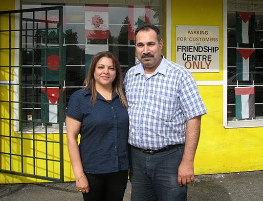 Adel Masoud, with his wife Layla, in front of the Middle Eastern Friendship Centre.|Photo by Ediz Dikmelik