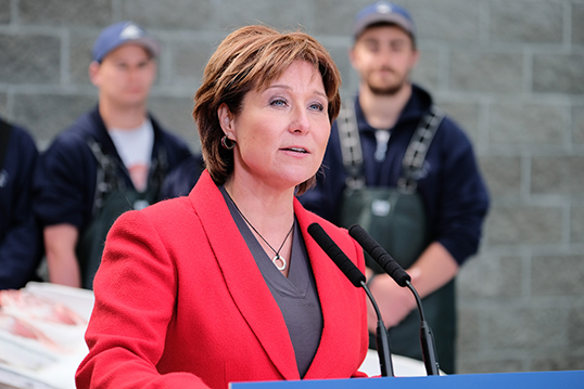 """It would take a worker making minimum wage more than two years to make what Clark gets for her """"car allowance.""""   Photo courtesy of the Province of British Columbia"""