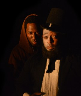 """Aadin Church as """"Lincoln"""" and David Lloyd as """"Booth"""" perform in Topdog/Underdog, a play by Suzan-Lori Park. 