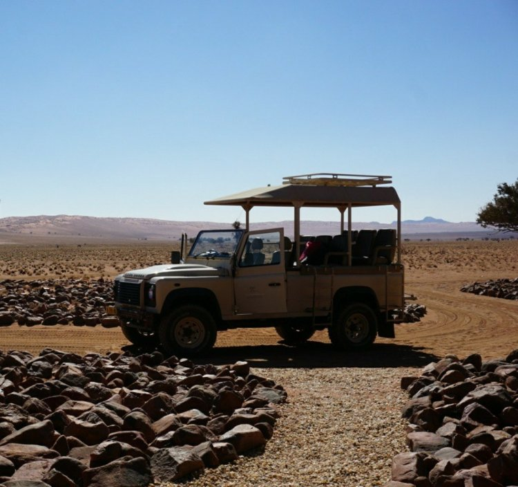 Private safari vehicle at Wolwedans Private Camp, Namibia.