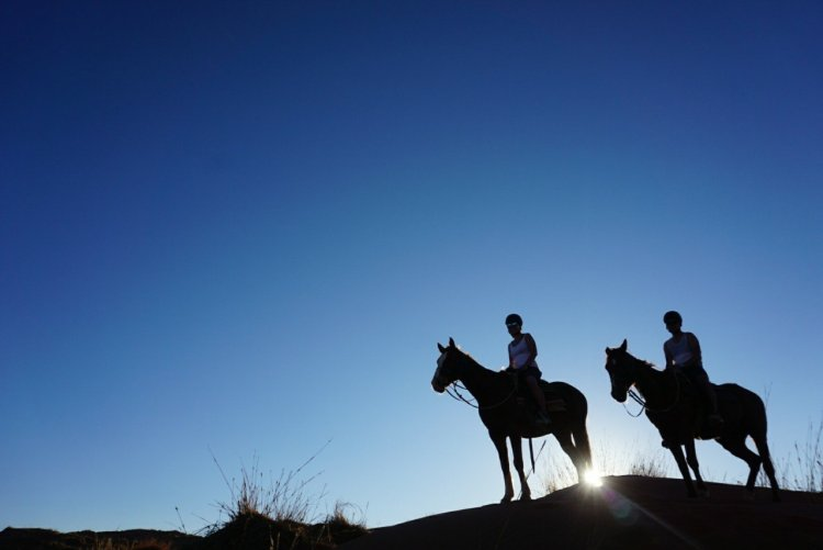 Horse riding at Wolwedans Private Camp.