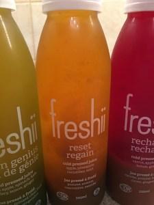 photo of freshii juice bottles