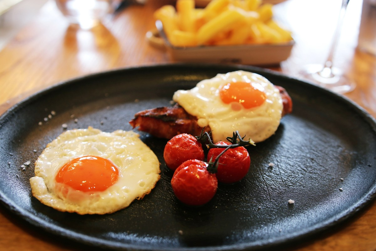 Bacon chop and fried eggs Gillray's Steakhouse London