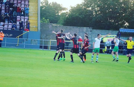 Longford players celebrate Daniel O'Reilly's winning goal v Cabinteely