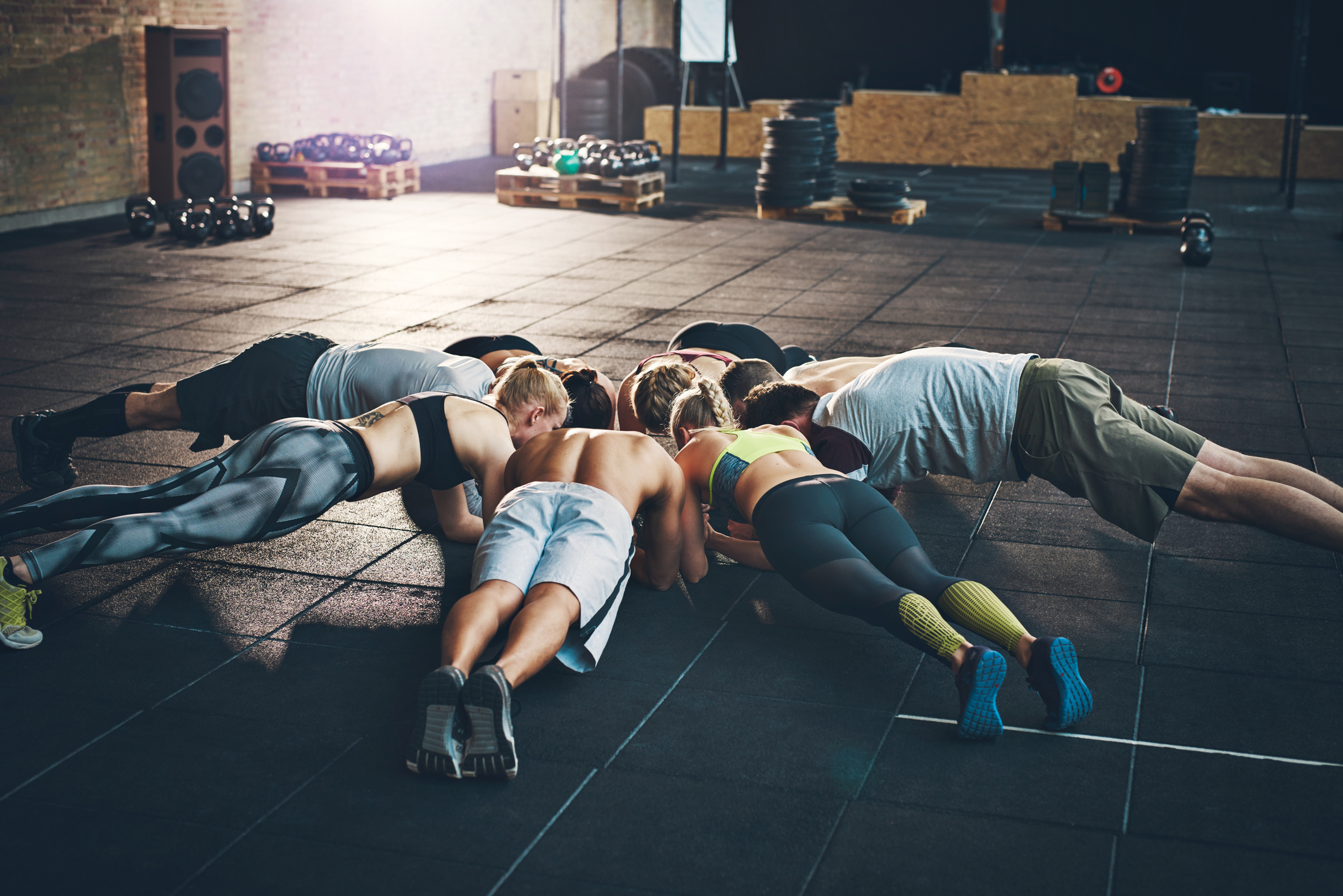 men and women planking together