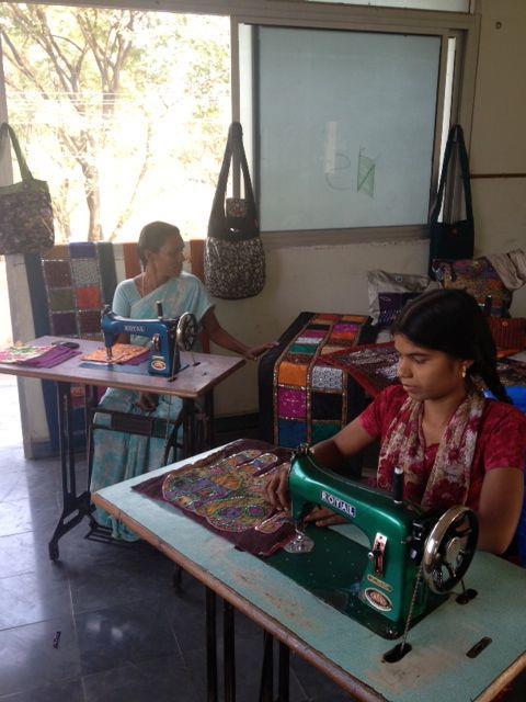 a.ku designs women at sewing machines