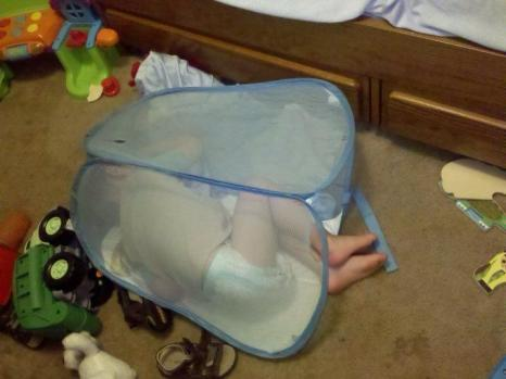 sleeping in mesh laundry hamper
