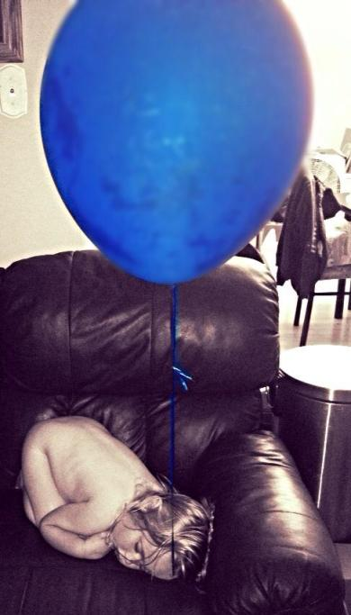 sleeping on chair with balloon