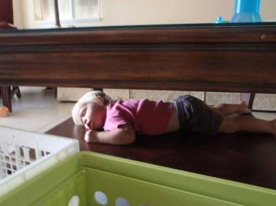 sleeping under the coffee table