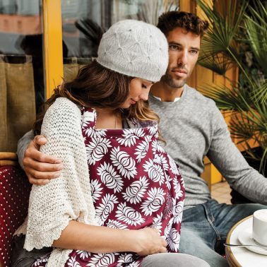 Breastfeeding in public with a breastfeeding cover. When you're a model family at an adorable cafe. Thanks to Bebe au Lait for this image.