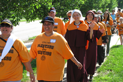 """Hundreds of walkers take part in the sixth annual """"Blisters for Sisters"""" walkathon at Church of the Nativity Parish in Leawood. With the money raised from the event, 19 communities will receive $1,000 each. By John Heuertz."""
