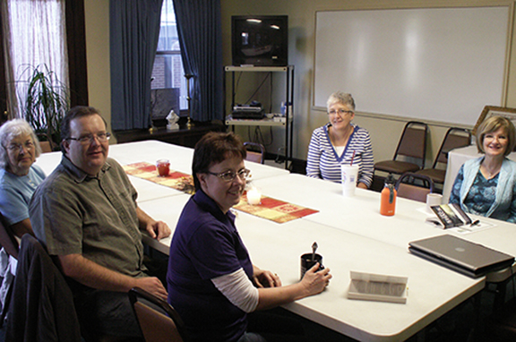 Book club members of Sacred Heart Parish in Emporia meet to discuss the group's latest reading selection. They are, clockwise from top: Brenda Mears, Connie Hudson, Angie Schreiber, Craig Carlson and Carolyn Carlson.