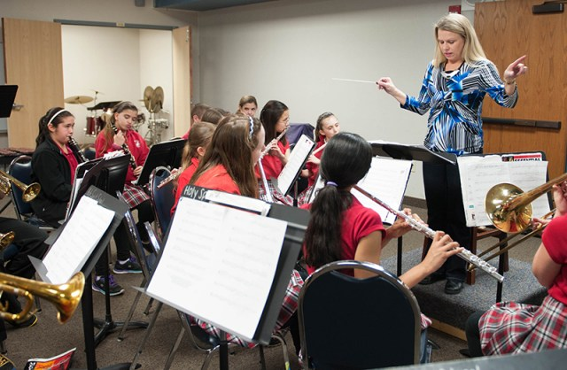 Connie Maltby directs the band during class at Holy Spirit School in Overland Park. Maltby was recently named outstanding music educator in the northeast district of the Kansas Music Educators Association.