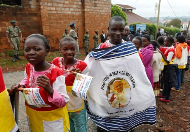 Children wait for Pope Francis' arrival outside a Catholic parish in the Kangemi slum on the outskirts of Nairobi, Kenya, Nov. 27. (CNS photo/Paul Haring)