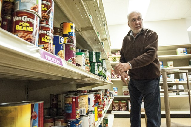 Rich Thornhill, a parishioner of Church of the Nativity in Leawood, works with three other volunteers at the Overland Park food pantry each Friday, stocking shelves and helping clients pick out the food they need.