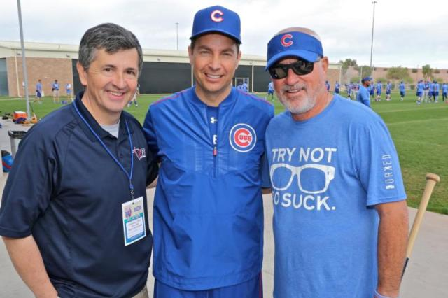Father Burke Masters, center, the Chicago Cubs' Catholic chaplain, poses with Ray McKenna, left, founder of Catholic Athletes for Christ, and Cubs Manager Joe Maddon during Cubs spring training in March 2016 at Sloan Park in Mesa, Ariz. (CNS photo/Ed Mailliard, courtesy Topps) See CUBS-CHAPLAIN Oct. 28, 2016.