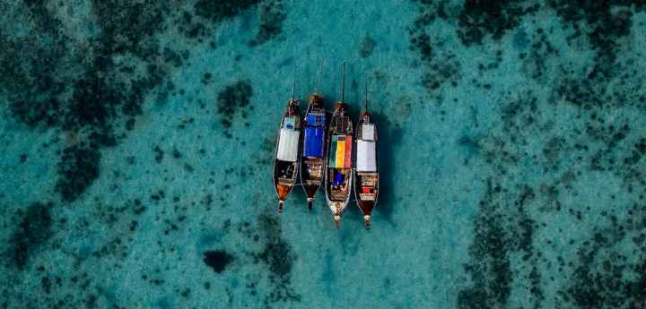 four boats on sea
