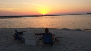 Tami watching the sunset at Dauphin Island.