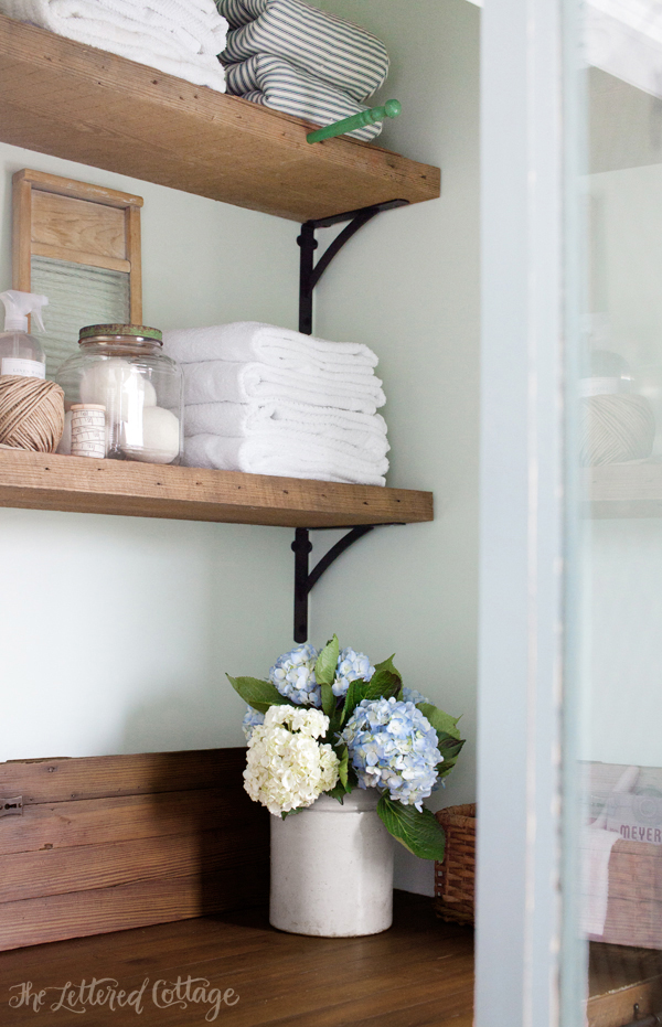 Laundry Room Countertop and Reclaimed Wood Shelves   The ... on Laundry Room Shelves Ideas  id=53791