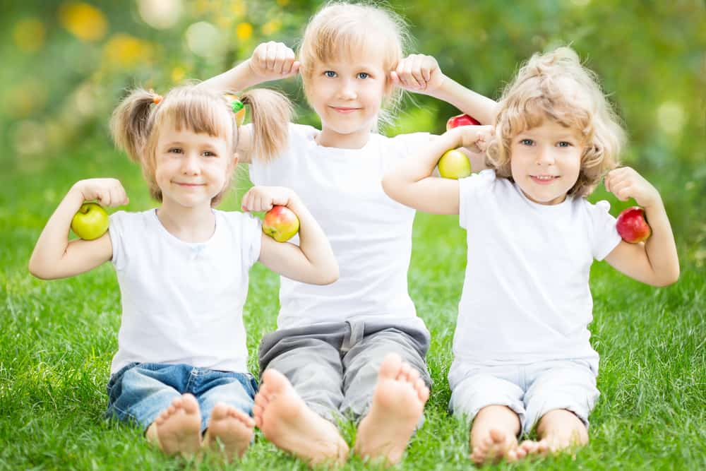 Kids with healthy fruit The Libby Group
