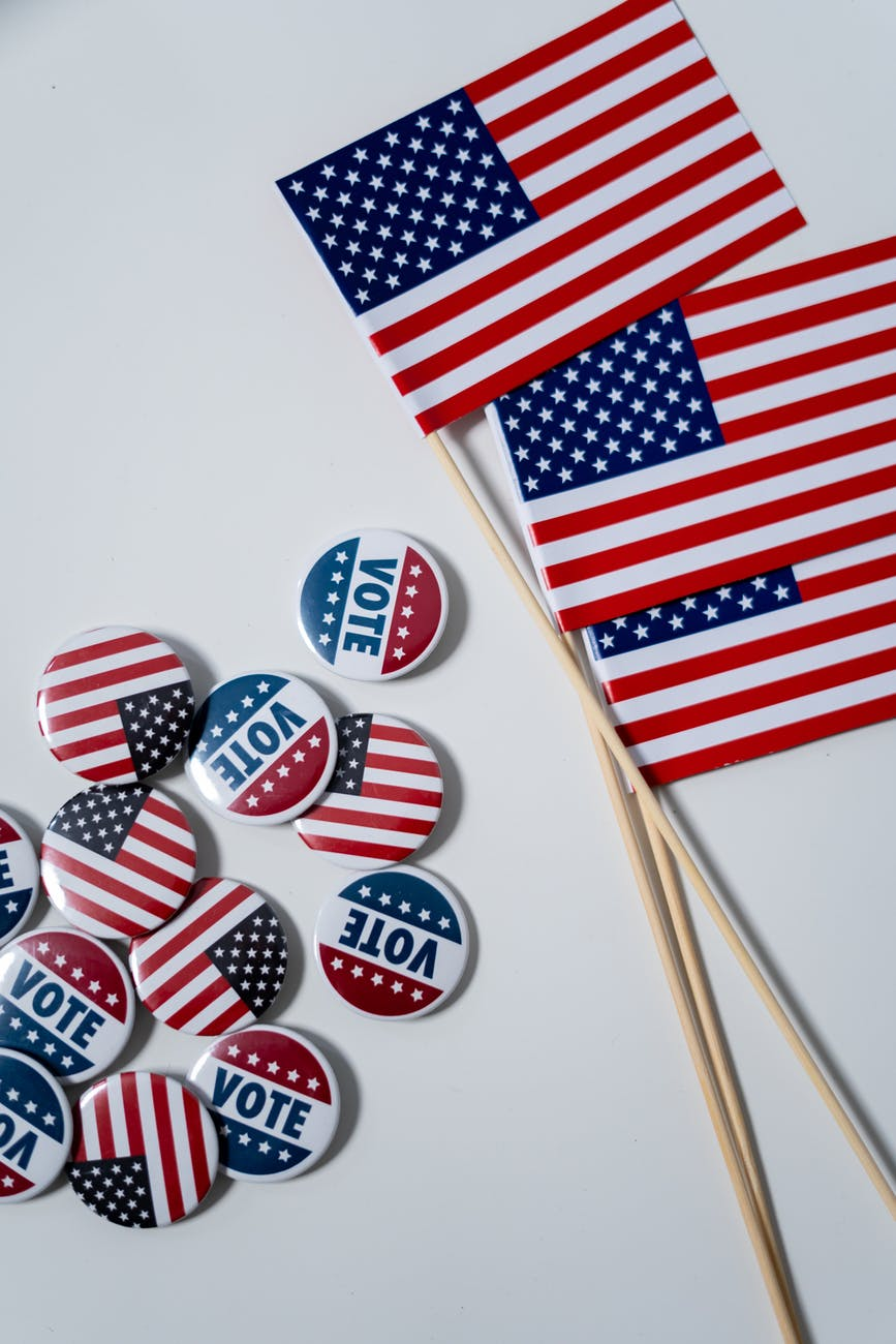 american flags and pins on white background