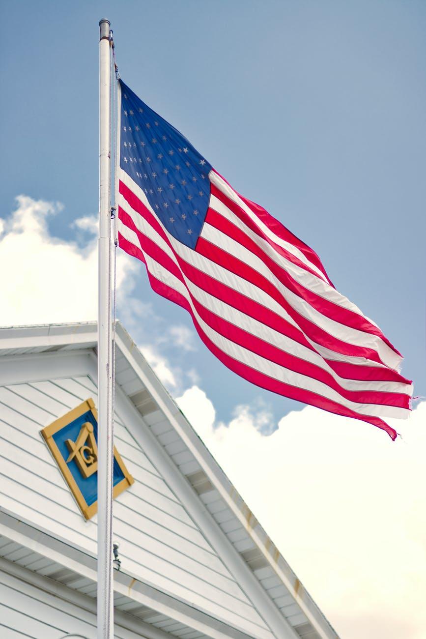 u s a flag mounted on white steel pole
