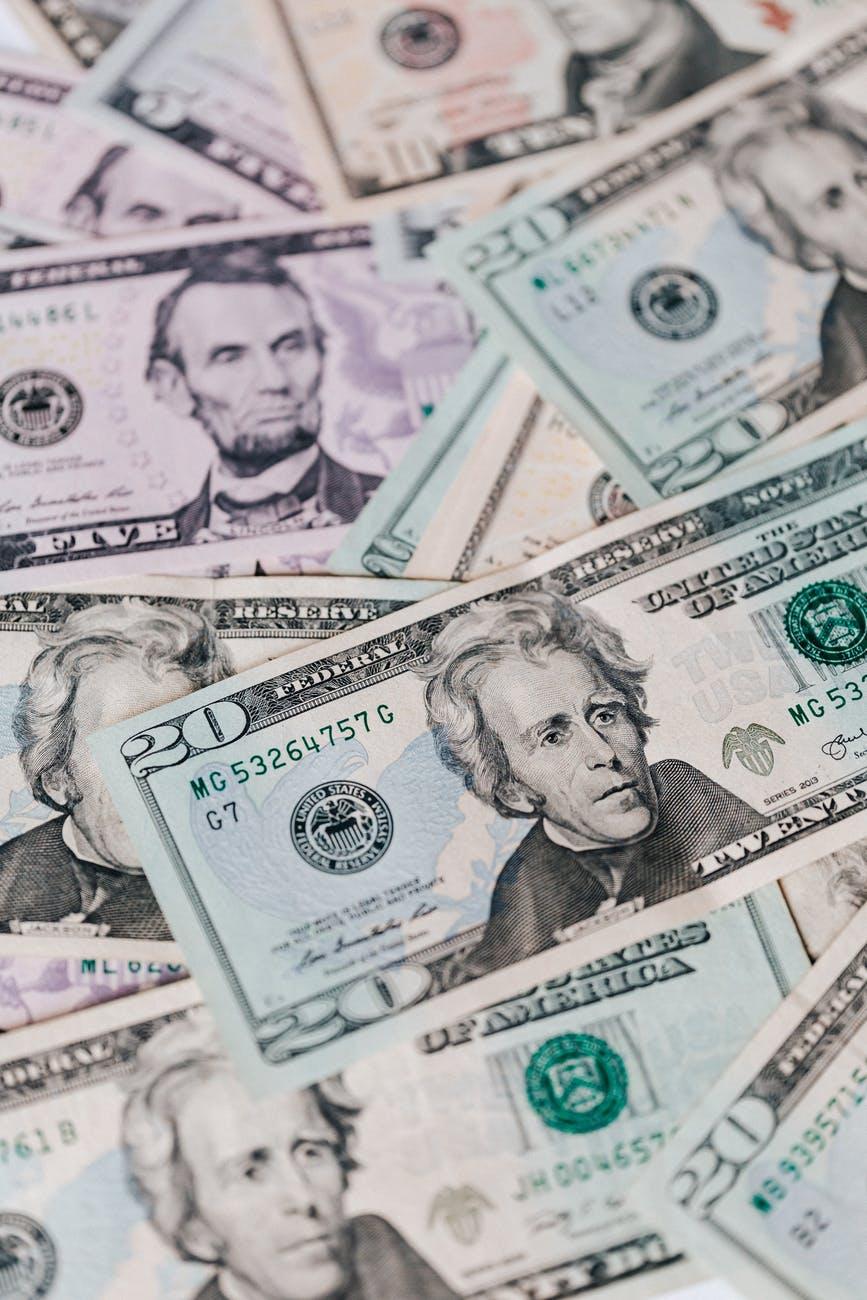 stack of various us dollar bills