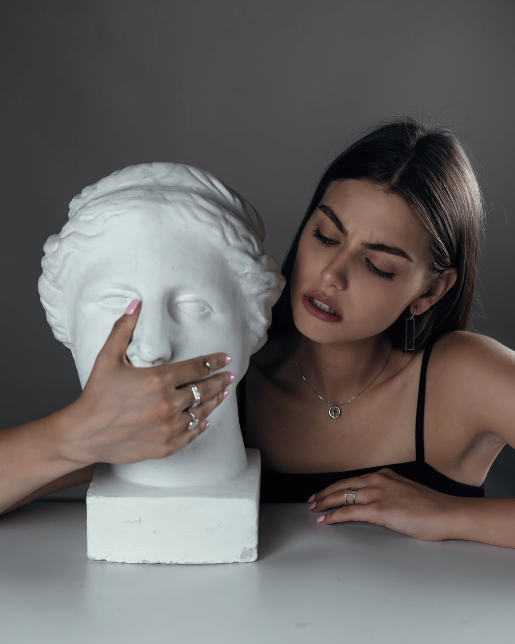 young woman with bust sculpture