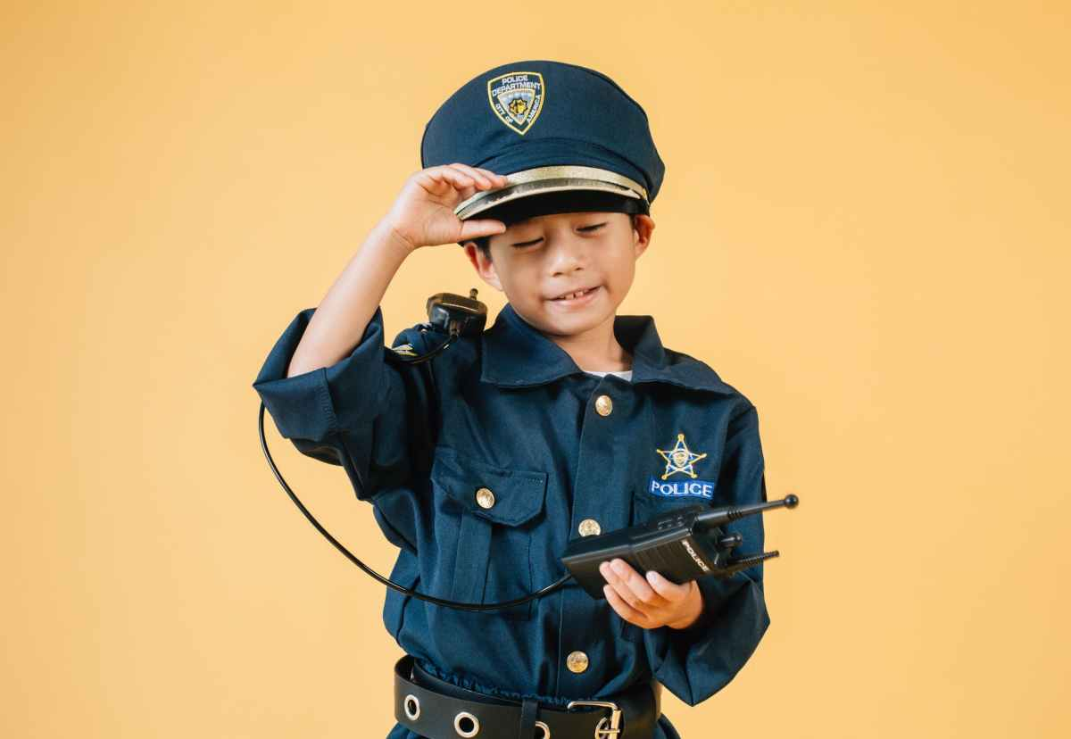 ethnic kid in police uniform in studio
