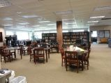 """AFTER: I created two """"classroom"""" areas separated by three nonfiction shelves."""